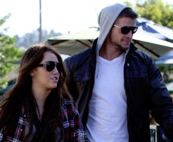Photo of Miley Cyrus with Liam Hemsworth