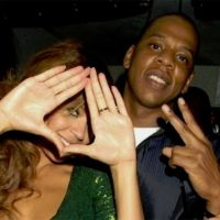 Picture of Beyonce and Jay-Z holding up an Illuminati sign