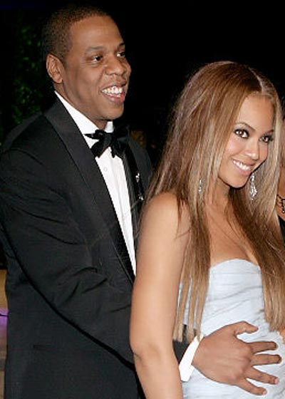 Photo of Jay-Z holding Beyonce Stomach