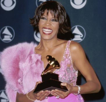 Photo of Whitney Houston holding a Grammy Award