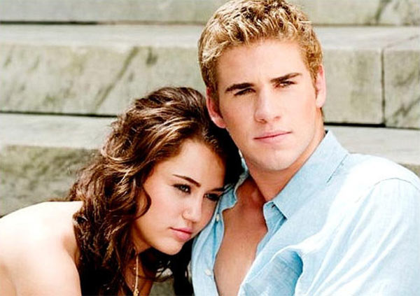 Photo of Miley Cyrus leaning on Liam Hemsworth shoulder