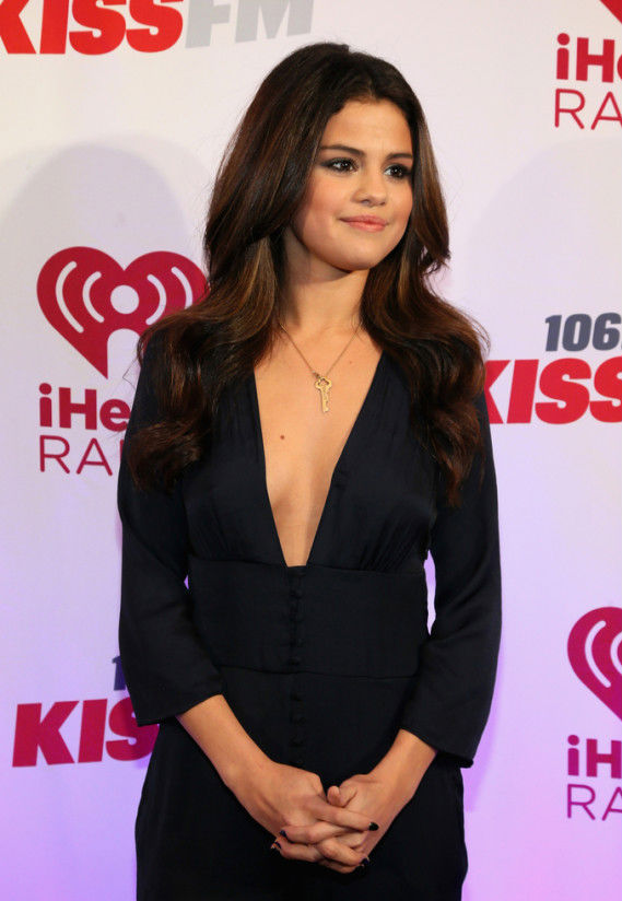 Selena Gomez lowcut jumpsuit at Jingle Bell in Dallas Texas