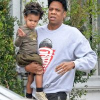 Dad Jay-Z holds Blue Ivy as the heads towards car