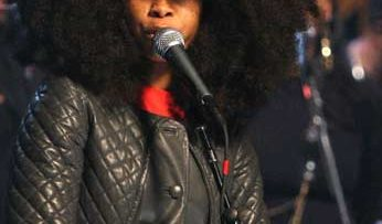 Photo of Erykah Badu on stage performing