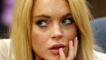 Photo of Lindsay Lohan with hand on lip