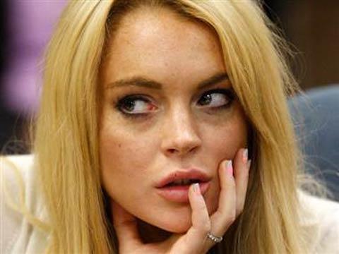 Photo of Lindsay Lohan with hand on lip