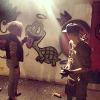 Kelly Osbourne and Justin Bieber graffiti art together